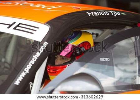 Sepang, Malaysia - September 5, 2015 : Netherlands Francis Tjia of Team Openroad Racing prepares of race at Porsche Carrera Cup Asia AFOS, Sepang, Malaysia