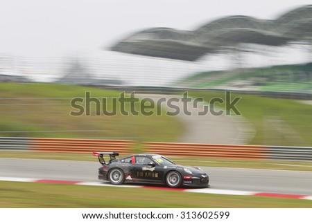 Sepang, Malaysia - September 4, 2015 : Team Budweiser Absolute Racing car 58 exits turn 2 at Porsche Carrera Cup Asia AFOS, Sepang, Malaysia  - stock photo