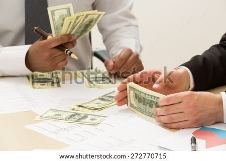 Separation of money. Earned money for a successful project. - stock photo