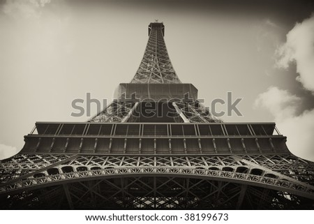 Sepia antique plate picture of the Eiffel Tower in Paris The vignetting and toned sepia are intentional - stock photo