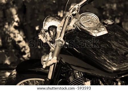 Sepia close-up of a sleek motorcycle - stock photo