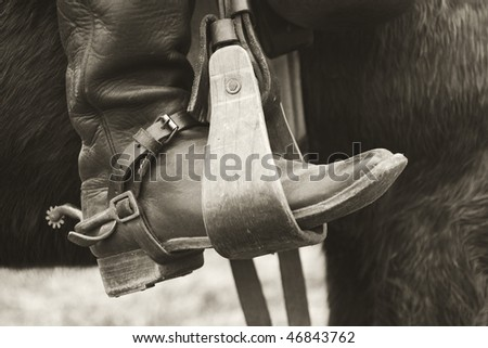 sepia cowboy boot - stock photo