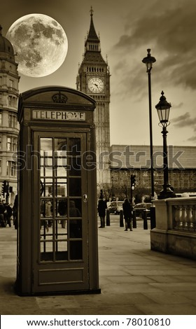 Sepia image of The Big Ben in London with a bright full moon and a phone booth in the foreground - stock photo