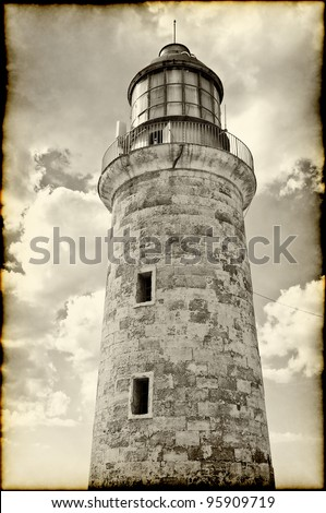 sepia image of the lighthouse tower in el Morro castle, Havana - stock photo