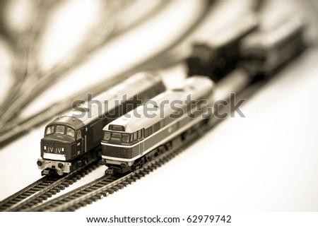 sepia locomotives on a miniature train set - stock photo
