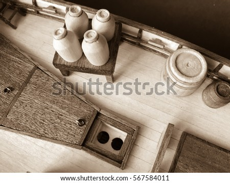 Sepia photo of wooden ship equipment close up view background wallpaper