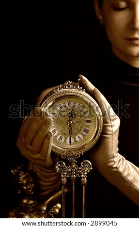 Sepia picture of a beautiful girl with a clock (focus on clock) - stock photo