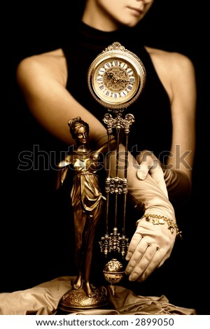 Sepia picture of a clock and beautiful young girl (focus on clock) - stock photo
