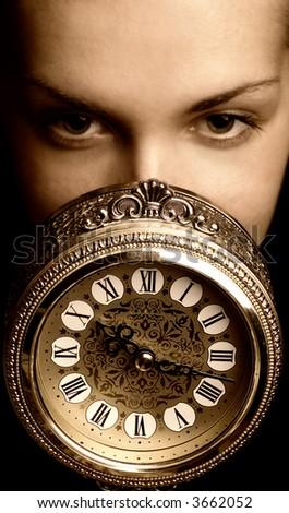 Sepia picture of a girl's face with a clock (focus on clock) - stock photo
