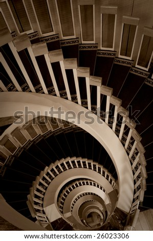 sepia picture of spiral stairway - stock photo
