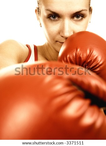 Sepia portrait of a girl in red boxing gloves - stock photo