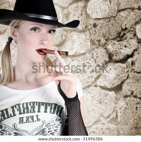 sepia portrait of cowgirl with red lips - stock photo