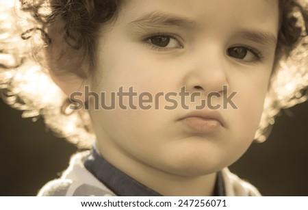 sepia portrait of little sad boy - stock photo