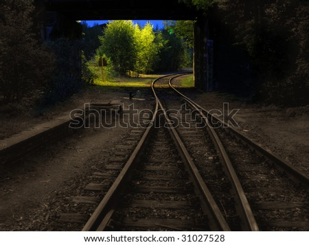 Sepia railway / railroad tracks which gradually disappear behind multicolored turn - stock photo