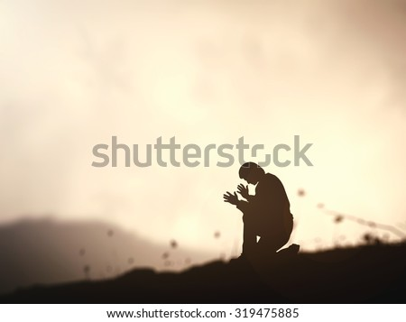 Sepia tone, lonely man praying over amazing light sunset background. Pray for Support Worship Forgiveness Mercy Humble Repentance Glorify Redeemer Human Rights Day International Mountain Trust concept - stock photo
