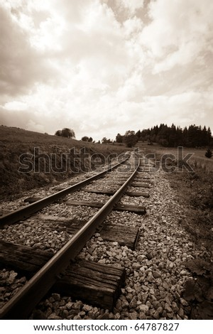 sepia tone picture of railway track leading to the horizon