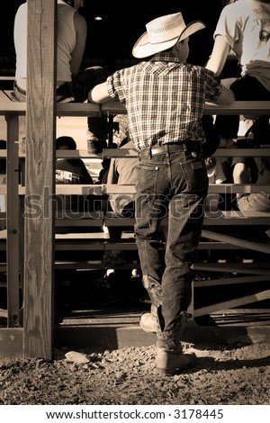 sepia tone western young man at a county fair - stock photo