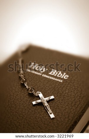 sepia toned bible with rosary - stock photo