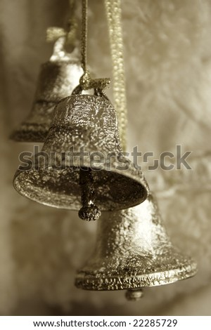 Sepia toned image of three silver bells - stock photo