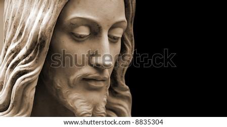 Sepia-toned Jesus statue, copy-space - stock photo