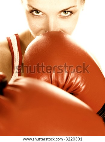 Sepia toned portrait of a girl with red boxing gloves - stock photo