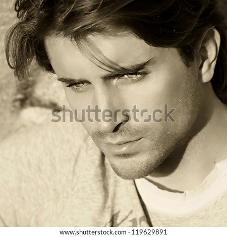 sepia toned portrait of handsome man - stock photo