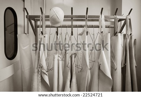 Sepia toned rack with work aprons