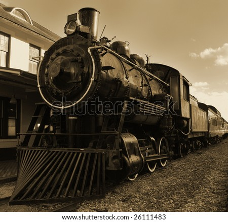 Sepia toned shot of old fashioned steam train