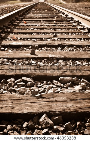 Sepia Vertical Railroad Track in Fall - stock photo