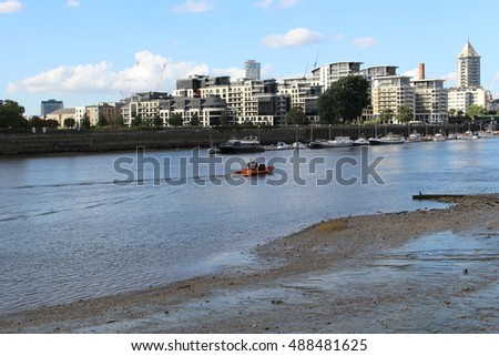 September 2016, a lifeboat operated by the Royal National Lifeboat Institution travels along the River Thames near Battersea, South West London