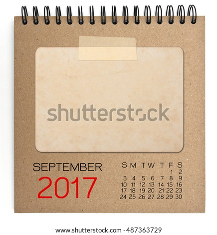 September 2017 calendar on brown notebook with old blank photo