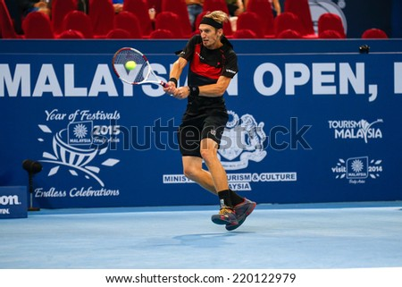 SEPTEMBER 25, 2014 - KUALA LUMPUR, MALAYSIA: Jarkko Nieminen of Finland makes a backhand return in his match at the Malaysian Open Tennis 2014. This is an ATP sanctioned tournament. - stock photo
