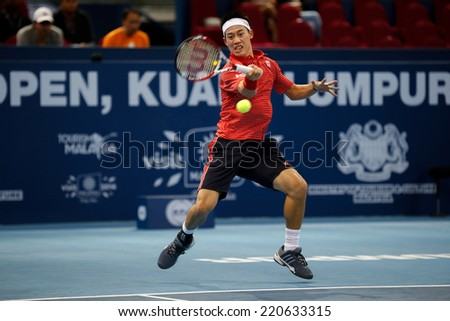SEPTEMBER 26, 2014 - KUALA LUMPUR, MALAYSIA: Kei Nishikori of Japan makes a forehand return in his match at the Malaysian Open Tennis 2014. This event is an ATP sanctioned tournament. - stock photo