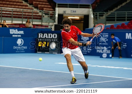 SEPTEMBER 23, 2014 - KUALA LUMPUR, MALAYSIA: Philipp Oswald from Austria makes a backhand return in his first round match at the Malaysian Open Tennis 2014 event. This is an ATP sanctioned tournament. - stock photo