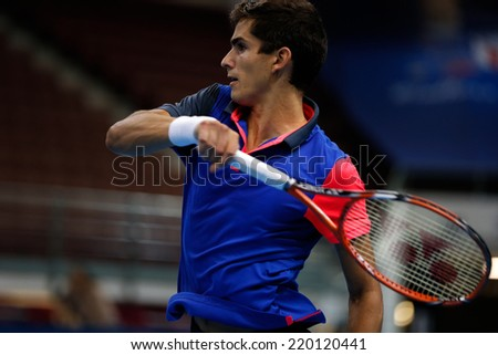 SEPTEMBER 23, 2014 - KUALA LUMPUR, MALAYSIA: Pierre-Hugues Herbert of France reacts after a return in his first round match at the Malaysian Open Tennis 2014. This is an ATP sanctioned tournament. - stock photo