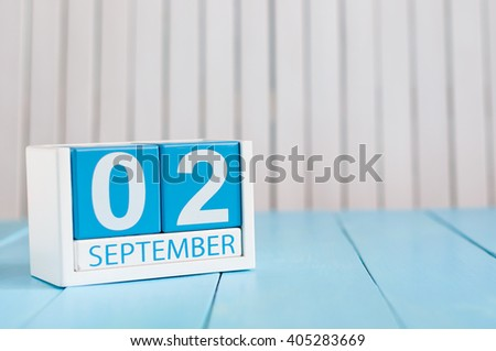 September 2nd. Image of september 2 wooden color calendar on blue background. Autumn day. Empty space for text - stock photo