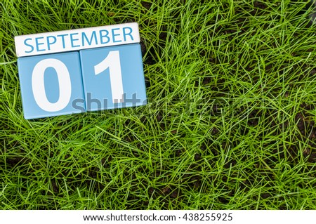 September 1st. Image of september 1 color calendar on green lrass lawn background. Autumn day. Empty space for text. Back to school time - stock photo