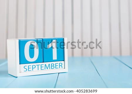 September 1st. Image of september 1 wooden color calendar on blue background. Autumn day. Empty space for text. Back to school time - stock photo