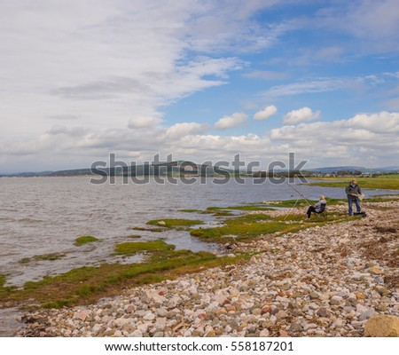 September 18th 2016. Bolton le sands, Morecambe, Lancashire, UK. Visitors fishing in the sea at Bolton le sands, Morecambe bay, Lancashire, UK