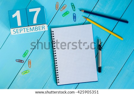 September 17th. Image of september 17 wooden color calendar on white background. Autumn day. Empty space for text - stock photo