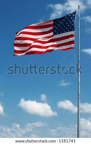 Sequence photo of stars and stripes waving in the wind on a sunny day - stock photo