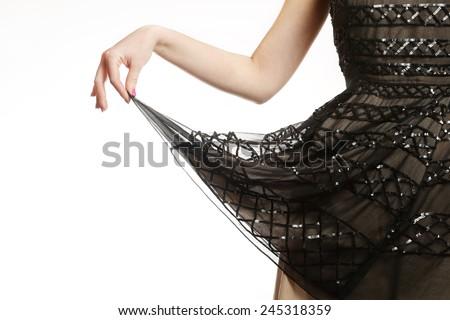 Sequin dress detail , Girl holding the hemline of her glamour sequin dress - stock photo