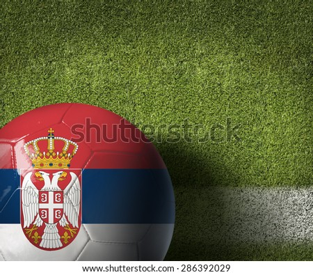 Serbia ball on green grass background