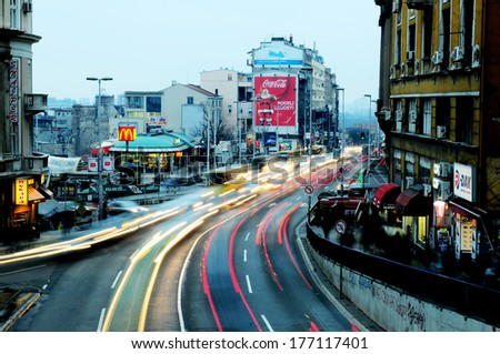 SERBIA, BELGRADE - DECEMBER 20, 2012: Motion blur image of car lights during rush hour at the exit of Terazije tunnel in Belgrade, Serbia - stock photo