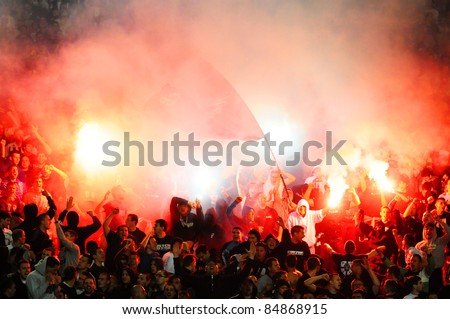 SERBIA, BELGRADE - MAY 11, 2011: Soccer or football fans celebrating goal with torches during Serbian cup final game between Vojvodina and Partizan - stock photo