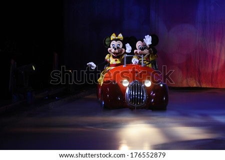 SERBIA, BELGRADE - NOVEMBER 1, 2013: Disney characters Mickey Mouse and Minnie Mouse riding in a car at Disney on Ice show / cartoon heroes - stock photo
