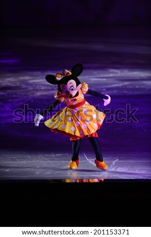 SERBIA, BELGRADE - NOVEMBER 1, 2013: Disney characters Minnie Mouse skating at Disney on Ice show / cartoon heroes - stock photo