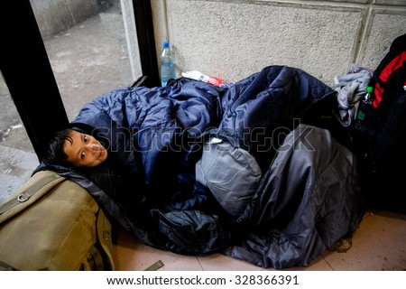 SERBIA, BELGRADE - October 17,2015: Park at the station migrants from Syria have turned into a small city. Some have even set up tents and in which they reside, while most sleep under the open sky