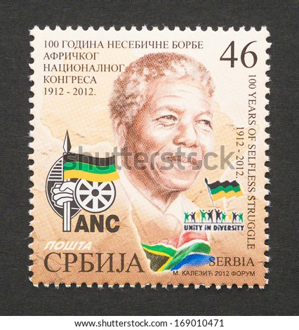 SERBIA - CIRCA 2012: postage stamp printed in Serbia showing an image of Nobel Peace prize winner Nelson Mandela, circa 2012.  - stock photo