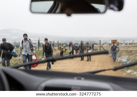SERBIA -September 2015: Wipe Lives -Rainy day, dirt road..The entry of immigrants to Serbia at the border crossing Miratovac, Macedonia